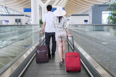 Young couple carrying suitcases for traveling Stock Photo