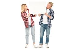 young couple in casual clothing holding blank banner together stock images