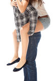 Man carrying girlfriend on his back Stock Image