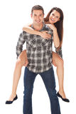 Man carrying girlfriend on his back Stock Photography