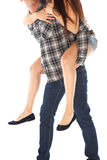 Man carrying girlfriend on his back Stock Images