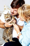 Young couple and cat at home royalty free stock photo