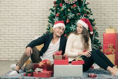 Young couple caucasian sitting on the carpet happy and enjon lo stock photo