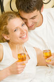 Young couple celebrating Stock Images