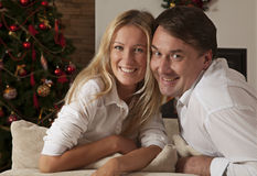 Young couple celebrating Christmas holidays Stock Images