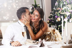Young couple celebrating Christmas at home Royalty Free Stock Image