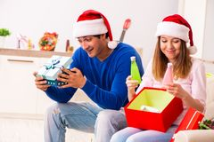 The young couple celebrating christmas at home stock images