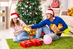 The young couple celebrating christmas at home royalty free stock photo