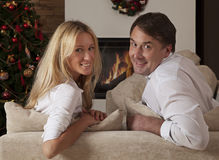 Young couple celebrating Christmas together Stock Photos