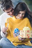 Young couple celebrating event with champagne glasses and gifts. Young happy couple celebrating event with champagne glasses and gift boxes, outdoor Stock Photos