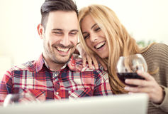 Young couple celebrating with red wine at home Royalty Free Stock Photos