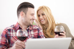 Young couple celebrating with red wine at home Stock Photos