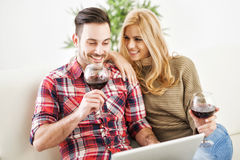 Young couple celebrating with red wine at home Royalty Free Stock Photography