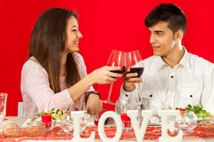 Young couple celebrating valentine's over dinner. Stock Photography