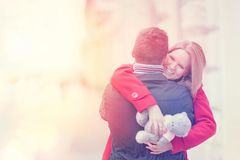 Young couple celebrating Valentines Day. Girl holding gift. stock images