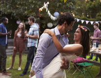 Young Couple Celebrating Wedding With Party In Backyard Stock Photography