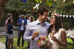 Young Couple Celebrating Wedding With Party In Backyard Royalty Free Stock Photography
