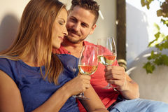 Young couple celebrating with white wine together Stock Photo