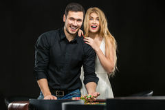 Young couple celebrating win at roulette table in casino. Stock Images