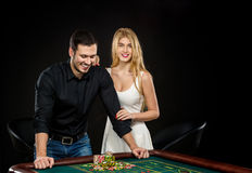 Young couple celebrating win at roulette table in casino. Stock Photography