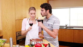 Young couple celebrating with wine. In the kitchen stock video footage