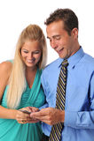 Young couple with cell phone stock images