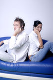 Young Couple on Cell Phones Stock Image