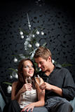 Young couple with champagne on Christmas Stock Images