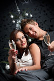 Young couple with champagne on Christmas Stock Image