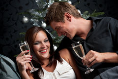 Young couple with champagne on Christmas Stock Photography