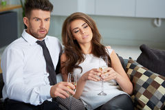 Young couple with champagne glasses. A young couple with champagne glasses celebrating Royalty Free Stock Image