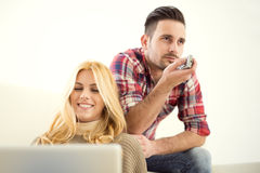 Young couple changing channels Royalty Free Stock Photo