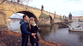 Young couple on the Charles Bridge stock video footage