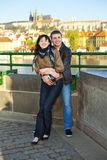 Young couple on the Charles Bridge on the skyline Stock Photo