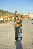 Young couple on the Charles Bridge on the skyline Stock Images