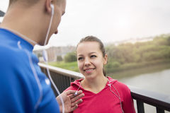 Young couple chatting on a bridge, smiling royalty free stock photography