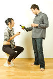 Young couple chatting over red wine Royalty Free Stock Images