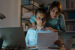 Young couple checking bills at night Royalty Free Stock Photos