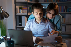 Young couple checking bills at night Royalty Free Stock Image