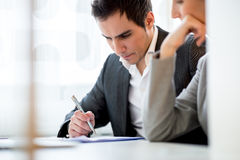 Young couple checking a document or contract Stock Image