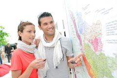 Young couple checking map wine-growing regions Royalty Free Stock Images