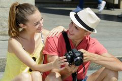 Young couple checking out photos on camera royalty free stock image
