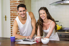 young couple checking their personal organizer in morning Royalty Free Stock Photos