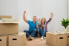 Young couple cheering in new home Royalty Free Stock Image