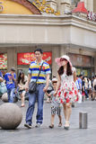 Young couple with child in commercial area, Shanghai, China Stock Images