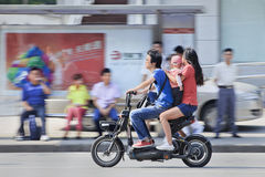 Young couple with child on an e-bike, Shanghai, China Royalty Free Stock Image