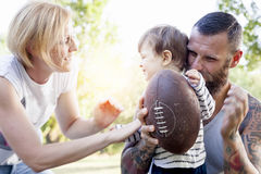 Young couple with child having fun Royalty Free Stock Photo