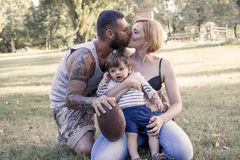 Young couple with child having fun at the park Royalty Free Stock Photos