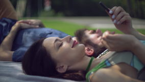 A young couple is chilling in the park. stock video footage