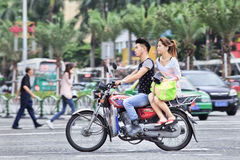 Young couple on a Chinese motorcycle, Zhuhai, China Royalty Free Stock Photos
